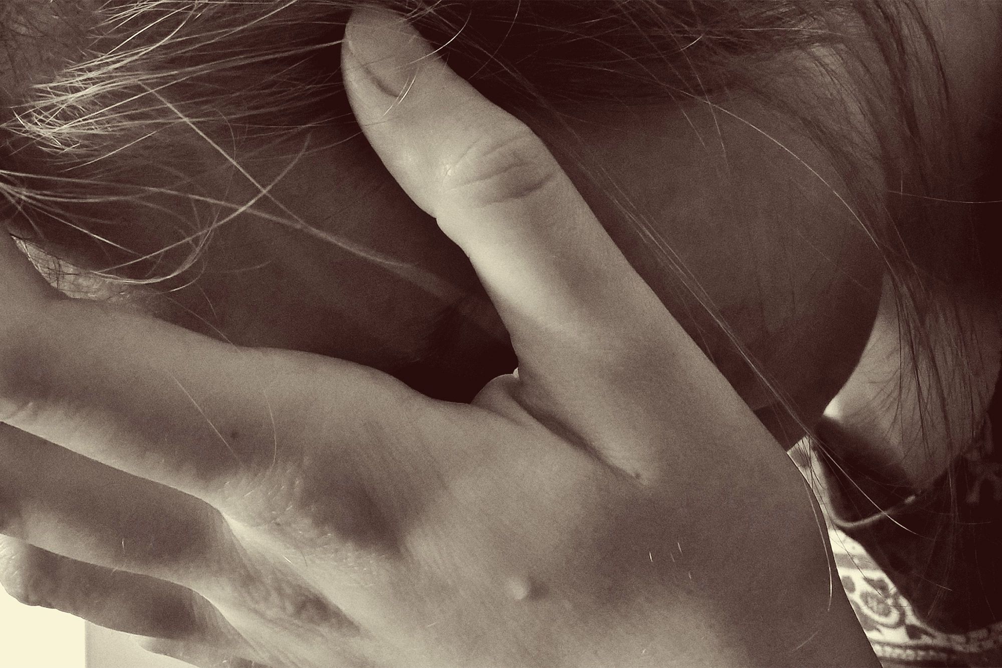 How to Write Through Stressful Times blog post featured image woman with her hand over her face