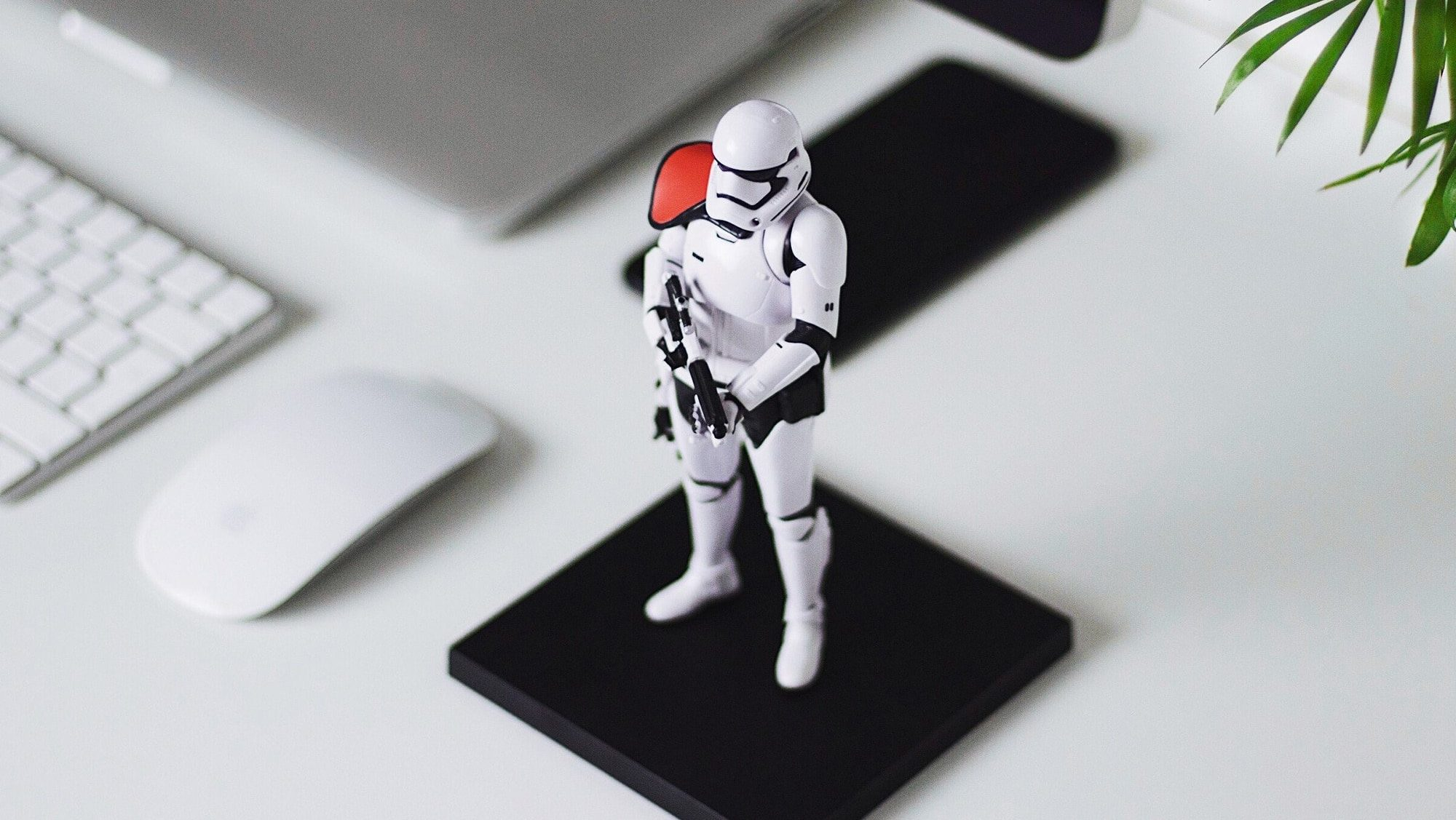 Warning signs a client may not pay featured image stormtrooper miniature on desk