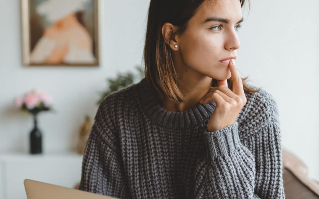 7 Self-Care Tips for Social Distancing as a Freelance Writer blog featured image woman with laptop looking out the window